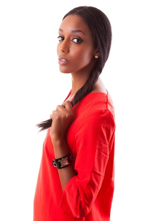 mixed race ethnicity: Portrait of a beautiful young black woman in red dress, isolated on white background