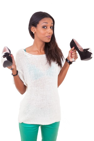 feminine beauty: Happy  african american woman holding a high heel shoe in her hands