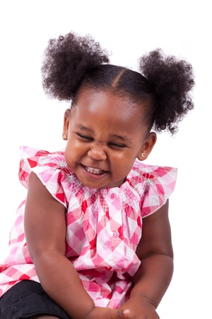 Cute little african american girl laughing, isolated on white background photo