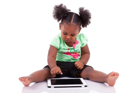 Little african american girl using a tablet  pc, isolated on white background Stock Photo - 14021966