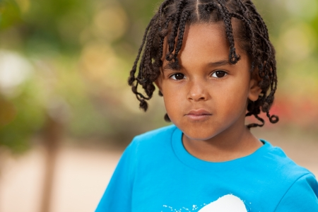 braided hair: Outdoor portrait of a cute african american little boy Stock Photo