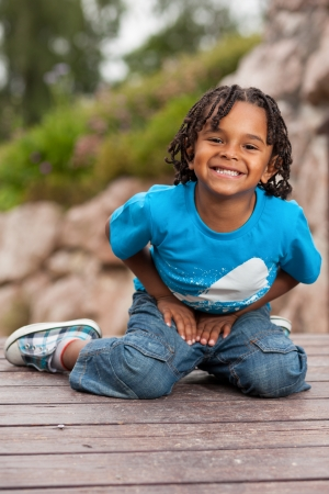 Outdoor portrait of a cute african american little boy photo