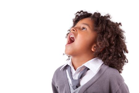 diversity children: Portrait of a cute african little boy screaming,isolated on white background