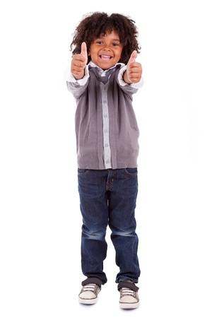 Portrait of a cute african little boy making thumbs up,isolated on white background Stock Photo - 14235050