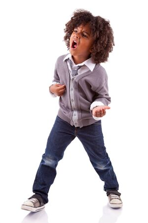 child singing: Little african american boy playing air guitar, isolated on white background