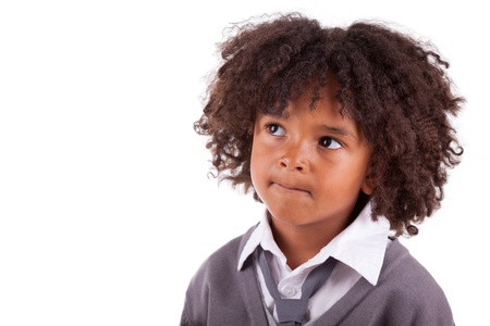 hesitating: Portrait of a thoughtful african american little boy,isolated on white background Stock Photo