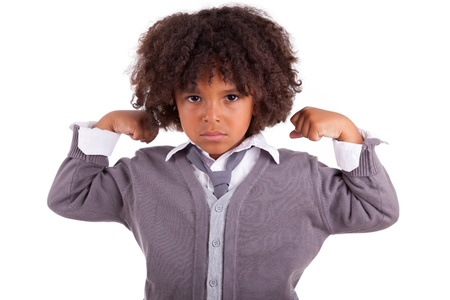 Portrait of a little african boy showing his muscles ,isolated on white background photo