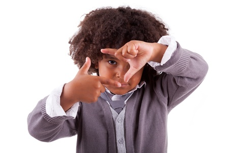 Little boy making frame sign with his hands, isolated on white background photo
