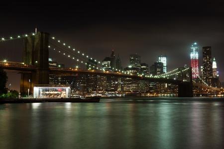 Manhattan skyline by night from Brooklyn bridge park - USA