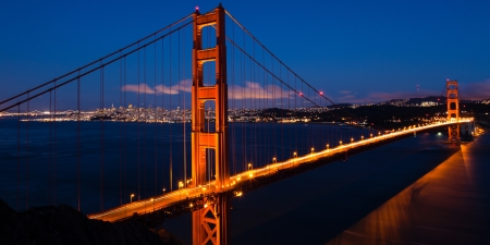 san francisco bay: Panoramic view of the  Golden Gate bridge by night in San Francisco - USA
