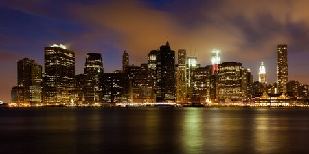 Manhattan skyline by night from Brooklyn bridge park - USA photo