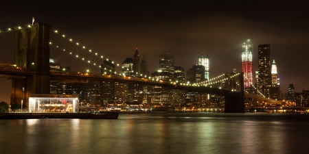 Panoranic view  of  Manhattan skyline by night from Brooklyn bridge park - USA