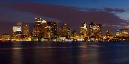 boston cityscape: Boston skyline by night from East Boston, Massachusetts - USA Stock Photo