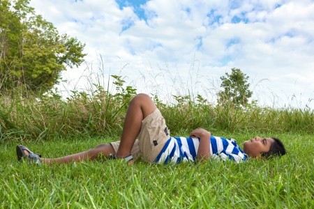 blue sky thinking: Outdoor portrait of a cute little indian boy looking to the sky
