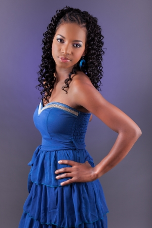 brazilian caribbean: Portrait of a young beautiful african american woman in blue dress looking up