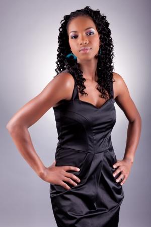 Young beautiful African amercian woman posing photo