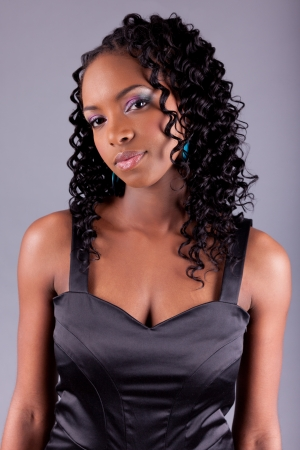 afro caribbean ethnicity: Young beautiful African amercian woman posing Stock Photo