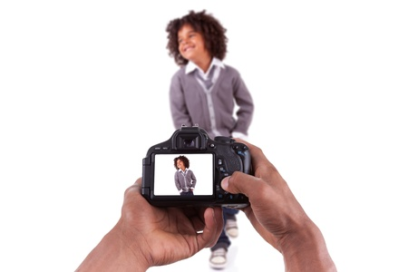 African american photographer taking studio pictures of a litle black boy photo