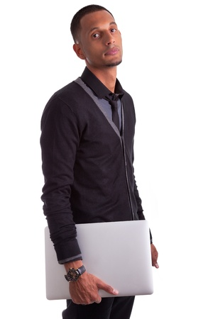 Young african american man holding a laptop, isolated on white background photo