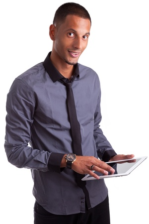 Young african american man using a tablet pc, isolated on white background Stock Photo - 15896330