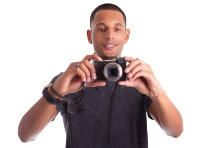 Portrait of a young african american man holding and taking a picture, isolated on white background Stock Photo - 15896324