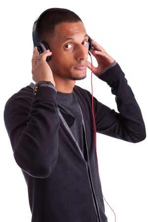 Young african american man listening to music, isolated white background Stock Photo - 15896331