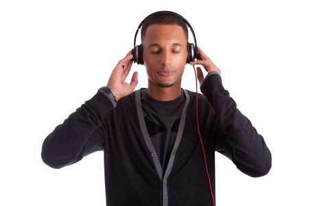 Young black man with closed eyes listening to music, isolated on white background Stock Photo - 16057552