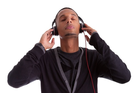 Young black man with closed eyes listening to music, isolated on white background photo