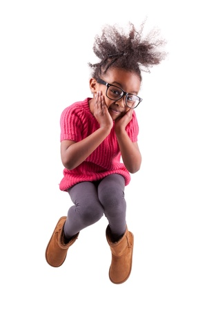 Portrait of cute Young African American girl jumping, over white background photo