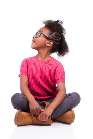 brazilian caribbean: Portrait of a cute young African American girl seated on the floor