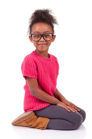 Portrait of a cute young African American girl seated on the floor photo