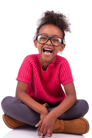 diversity children: Portrait of a cute young African American girl seated on the floor