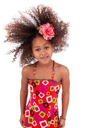 Portrait of a cute young African Asian girl playing with her hairs,isolated on white background Stock Photo - 16191208