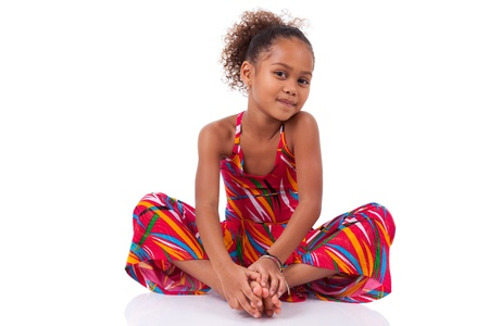 shy girl: Portrait of a cute young African Asian girl seated on the floor