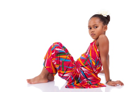 brazilian caribbean: Portrait of a cute young African Asian girl seated on the floor