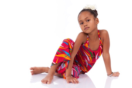 afro caribbean: Portrait of a cute young African Asian girl seated on the floor