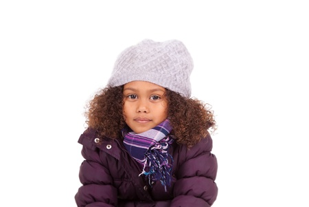 ethnic children: Little african asian girl wearing winter clothes,isolated on white background