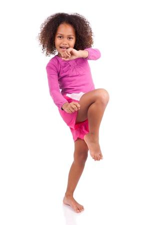 muay: Little muay thai boxing girl using her knee,isolated on white background