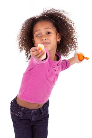 sharing food: Little African Asian girl sharing a tangerine ,isolated on white background