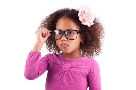 BLACK GLASS: Portrait of a cute little African Asian girl wearing glasses,isolated on white background