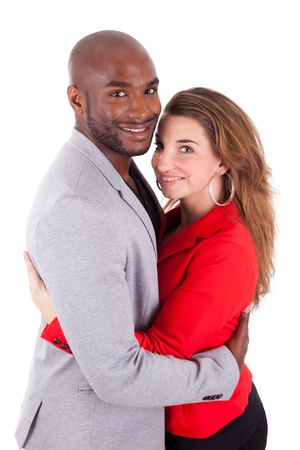 Portrait of a young happy mixed couple, isolated on white background photo