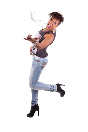 Portrait of a young beautiful black woman  playing air guitar, isolated on white background photo