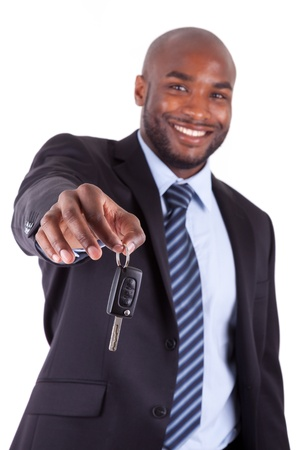 sales executive: Young African American businessman holding a car key,isolated on white background