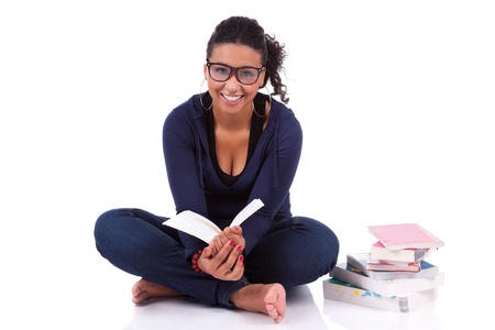 high school students: Young African American student girl reading a book, isolated on white background Stock Photo