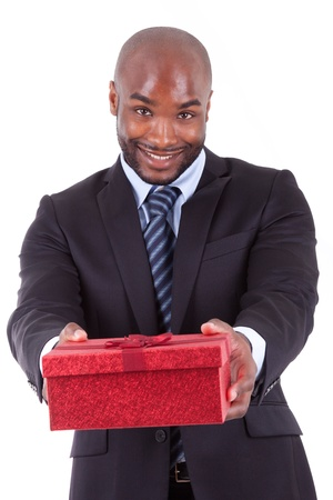 Young African American man offering a gift, isolated on white background photo
