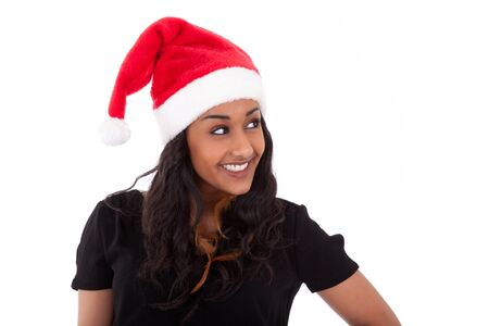 Young African American woman wearing a santa hat, isolated on white background photo