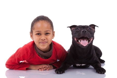 pitbull: African American little girl with her pet, isolated on white background Stock Photo