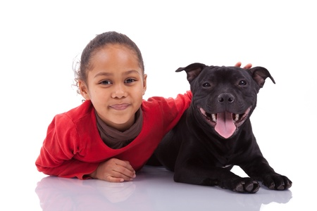 south african: African American little girl with her pet, isolated on white background Stock Photo