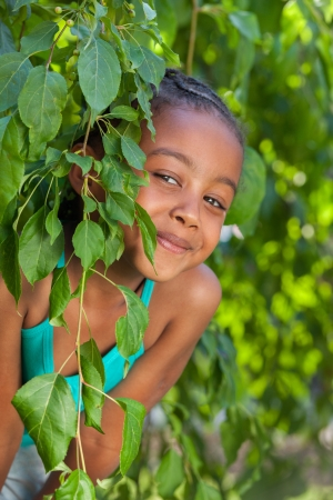 Outdoor portrait  of a cute little African American girl photo