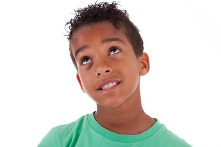 African children: Portrait of a cute african american little boy looking up, isolated on white background